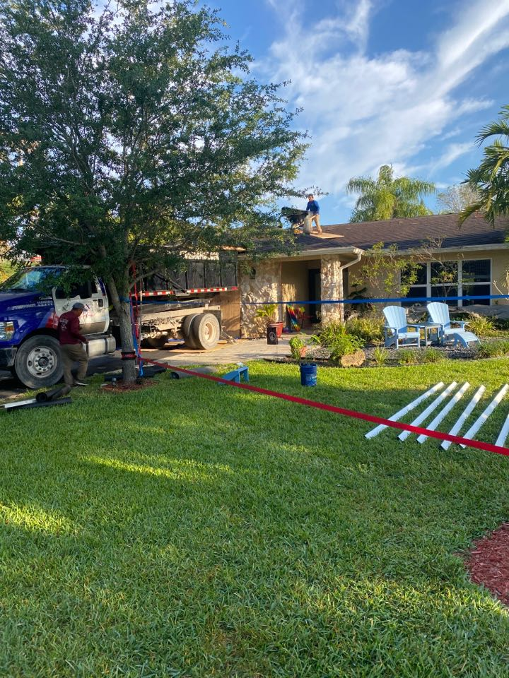 Southwest Ranches, FL - Re-roof and Southwest Ranches tearing off a shingle installing a GAF timberline HDZ Unlimited wind rating golden pledge warranty 25 year labor and material warranty