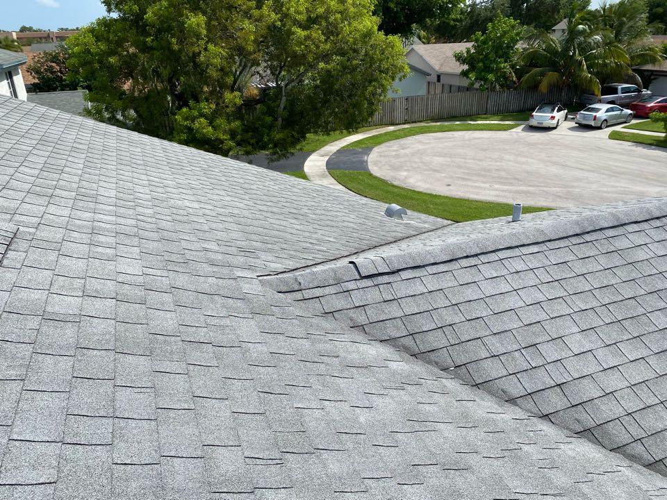 Gaf Timberline HDZ shingle and flat reroof estimate in Cooper City by Mike Wilde and Earl Johnston Roofing