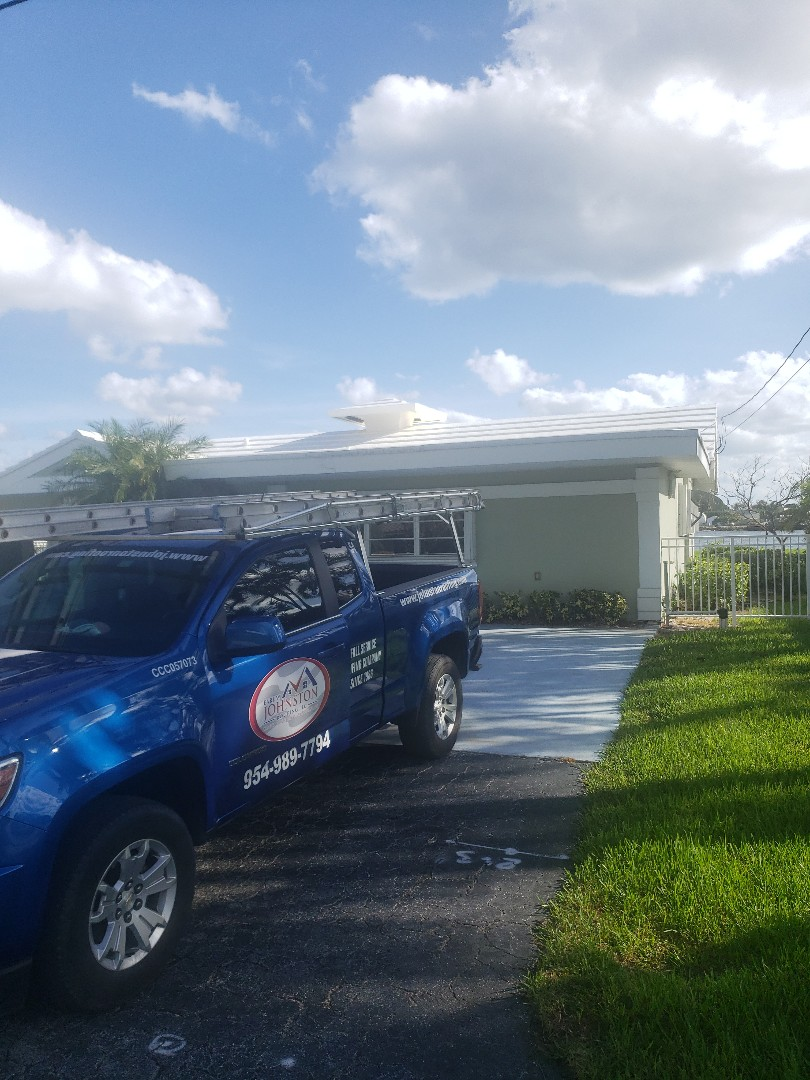 Metal and  concrete tile roof replacement estimate by AJ from Earl Johnston Roofing Company