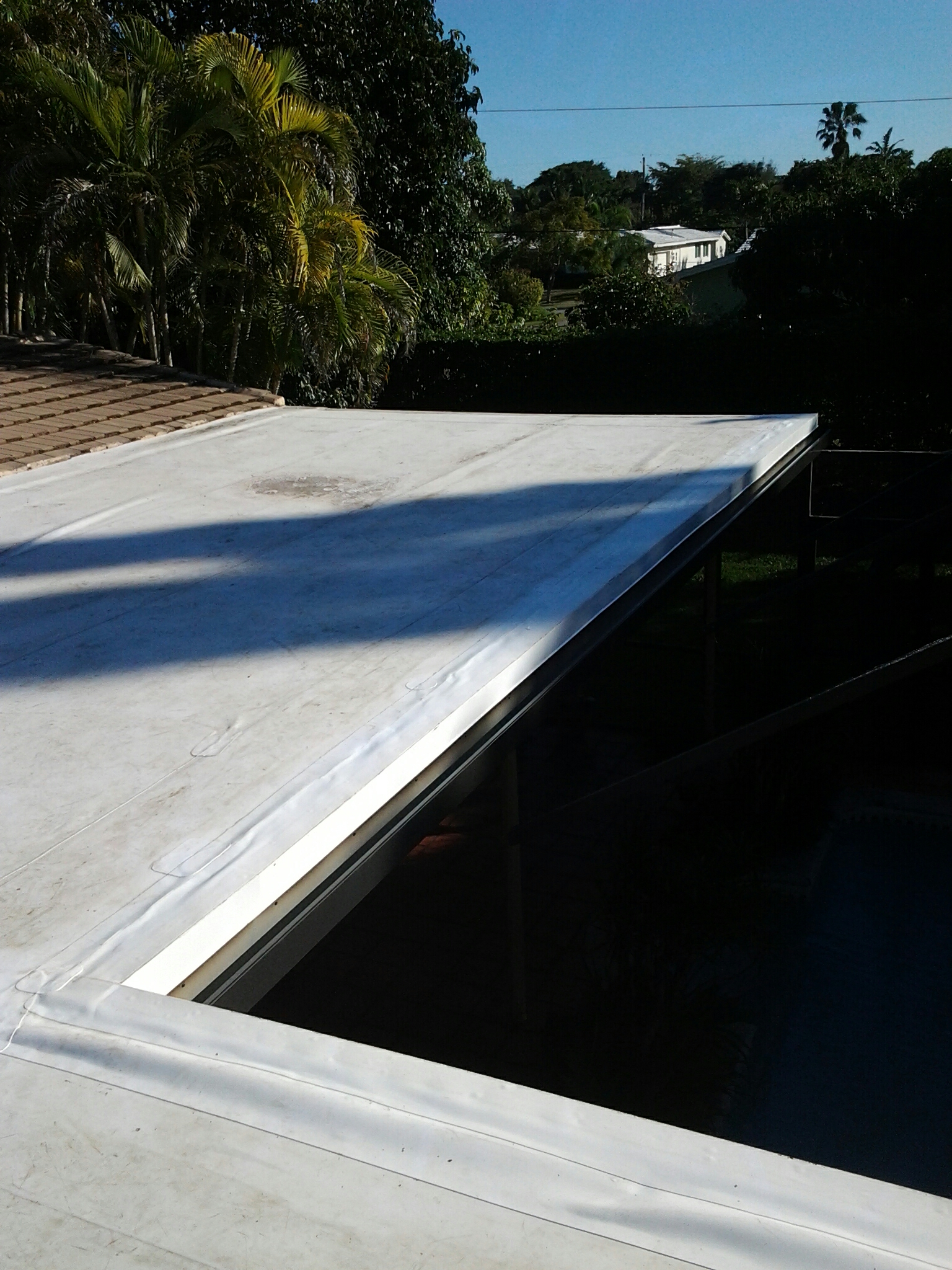 Palmetto Bay, FL - Mike and Earl Johnston roofing completed installing a new tpo edge.