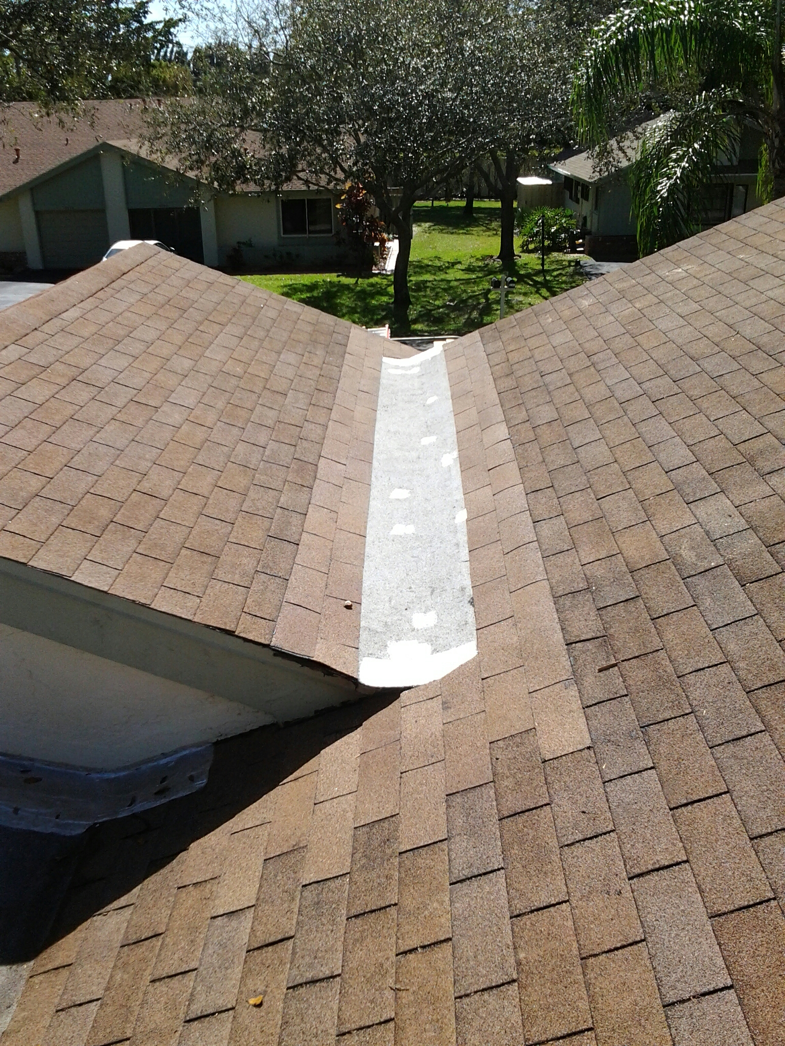 Delray Beach, FL - Mike and Earl Johnston roofing completed a cricket.