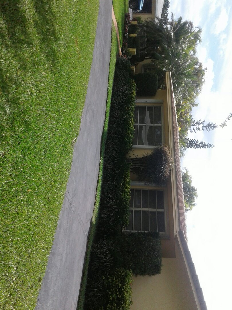 Palmetto Bay, FL - Roof repair in the city of Palmetto Bay this repair is being done by Earl W Johnston roofing company Tony and Jose are you repair technicians