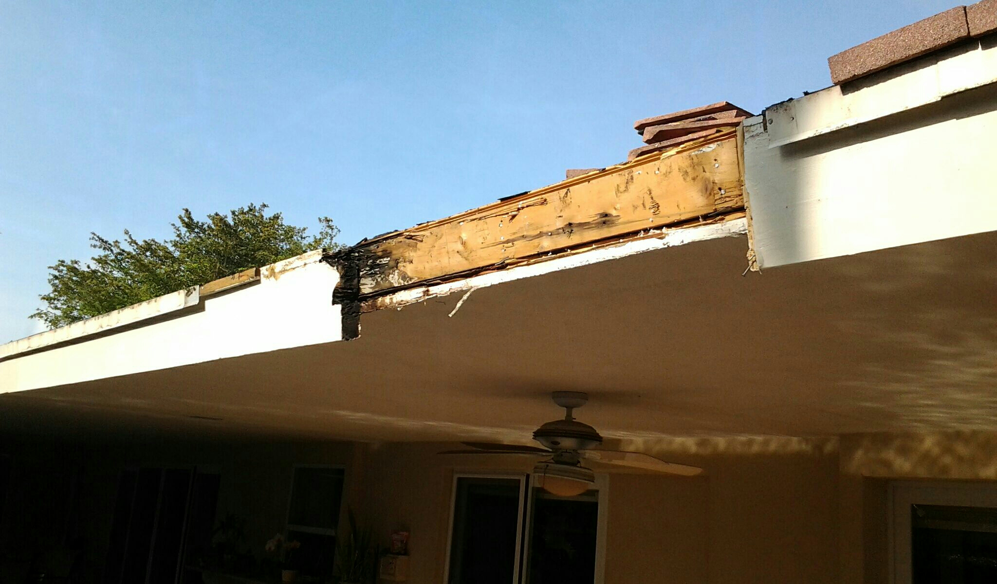 Pinecrest, FL - Mike and Earl Johnston roofing doing a tile repair with rotten fascia board.