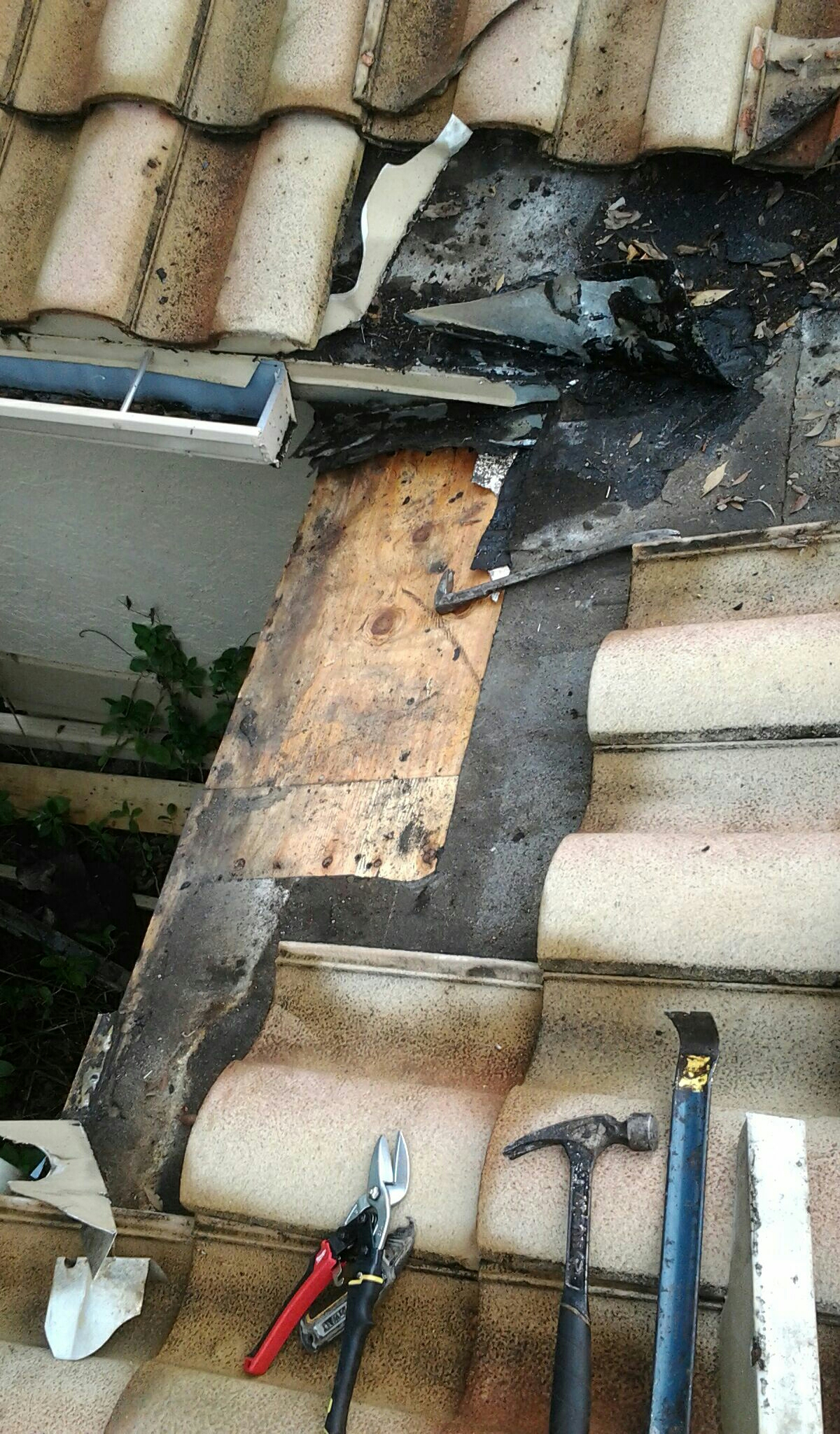 Coral Springs, FL - Mike and Earl Johnston roofing doing a tile repair. Leak located