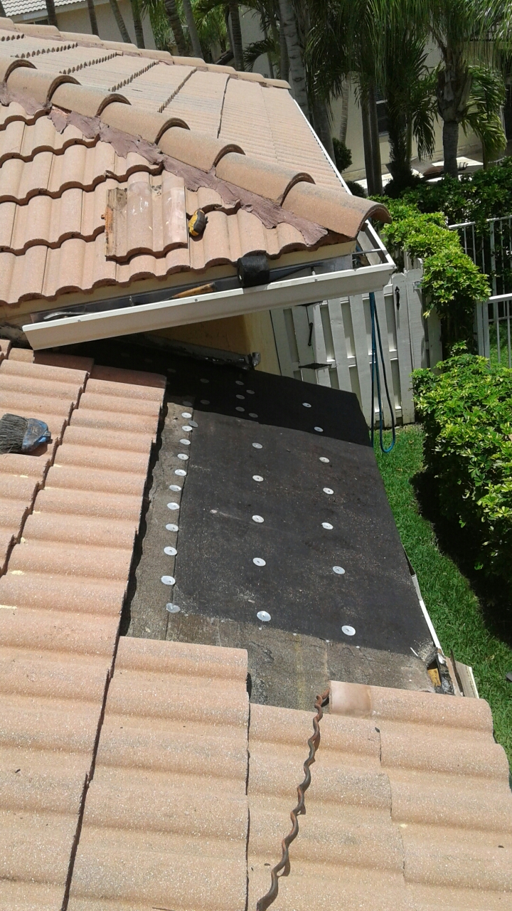 Weston, FL - Mike and Earl Johnston roofing ready to install second water barrier on one of 4 leak area