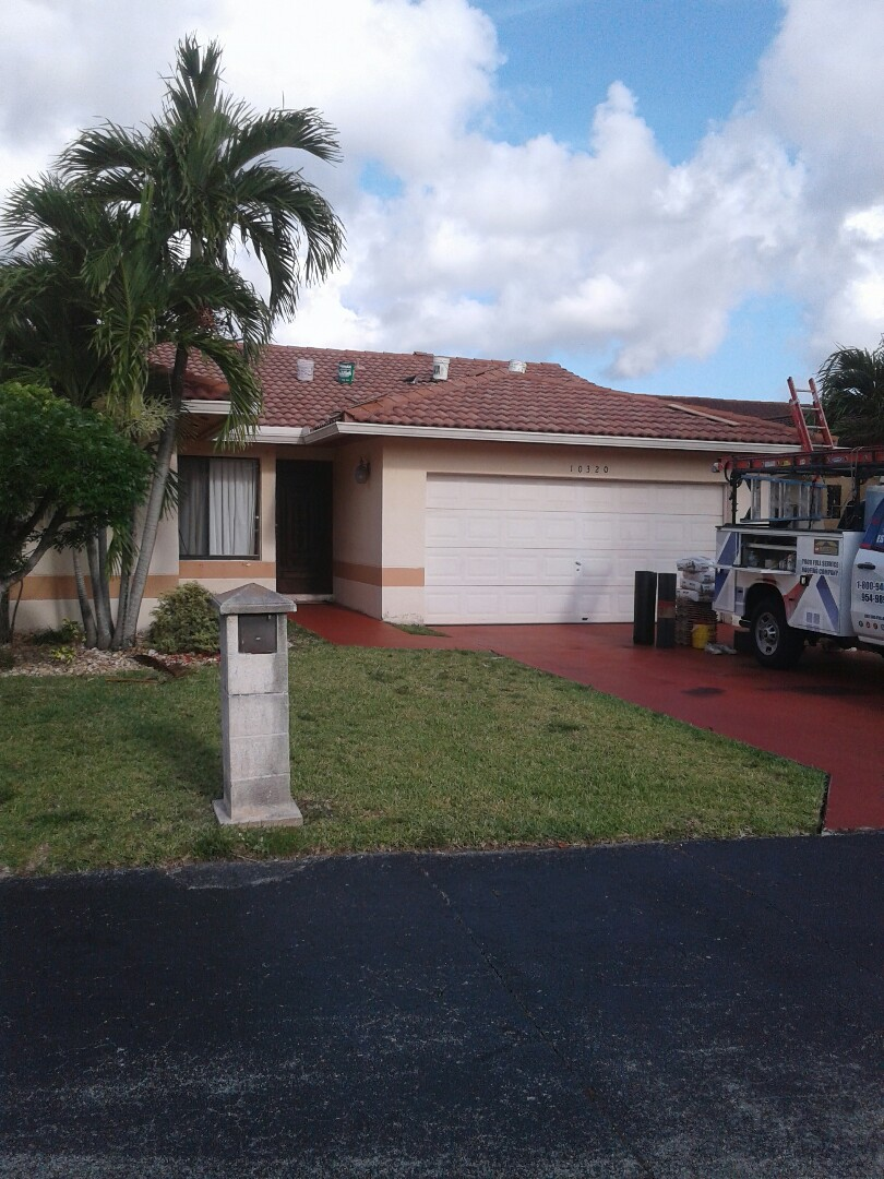 Miami, FL - Roof valley repair in the city of Miami Florida this repair is being done by Earl W Johnston roofing company Tony and Wayne are your repair technicians