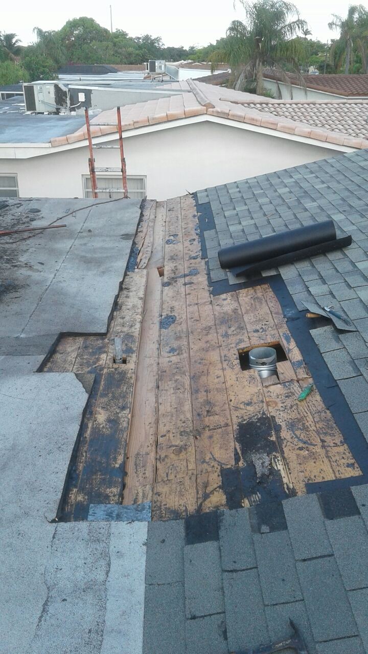 Hollywood, FL - Mike and Earl Johnston roofing replacing break area.