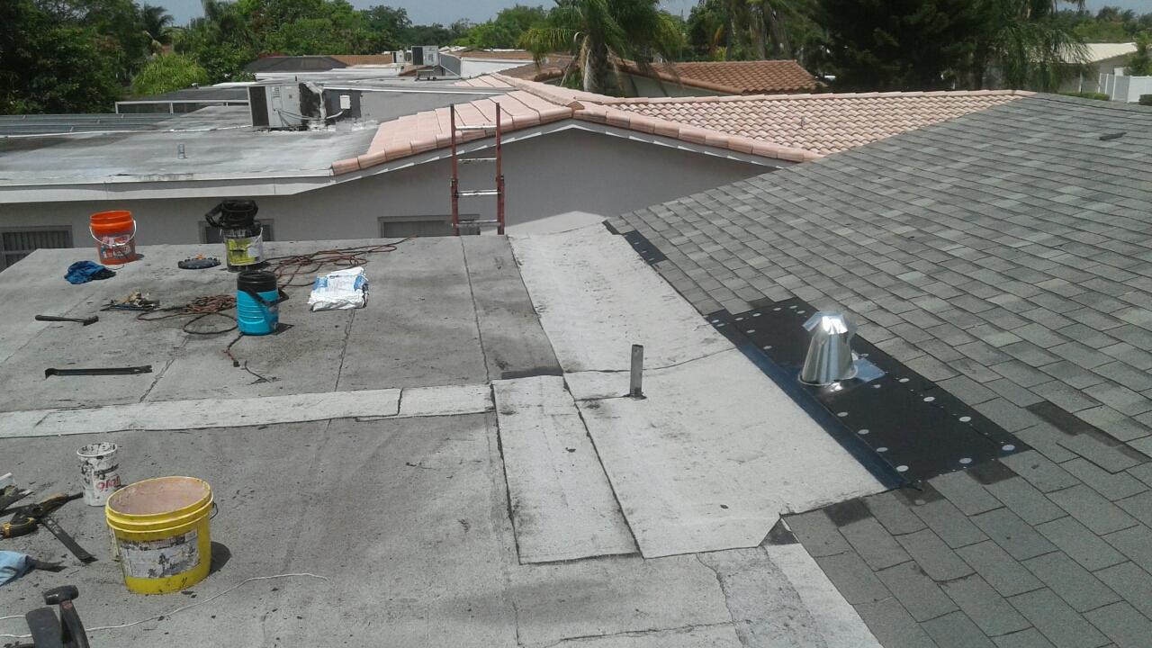 Hollywood, FL - Mike and Earl Johnston roofing installed new torch down