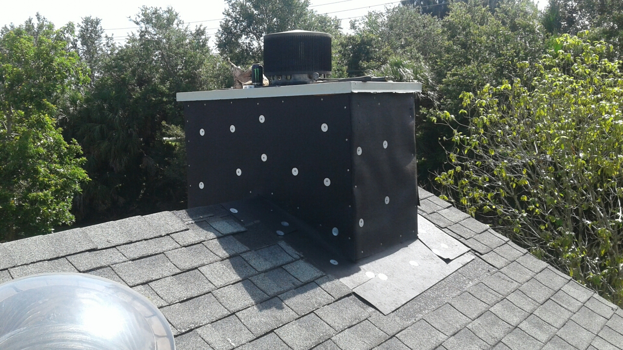 Davie, FL - Mike and Earl Johnston roofing doing repairs to a chimney