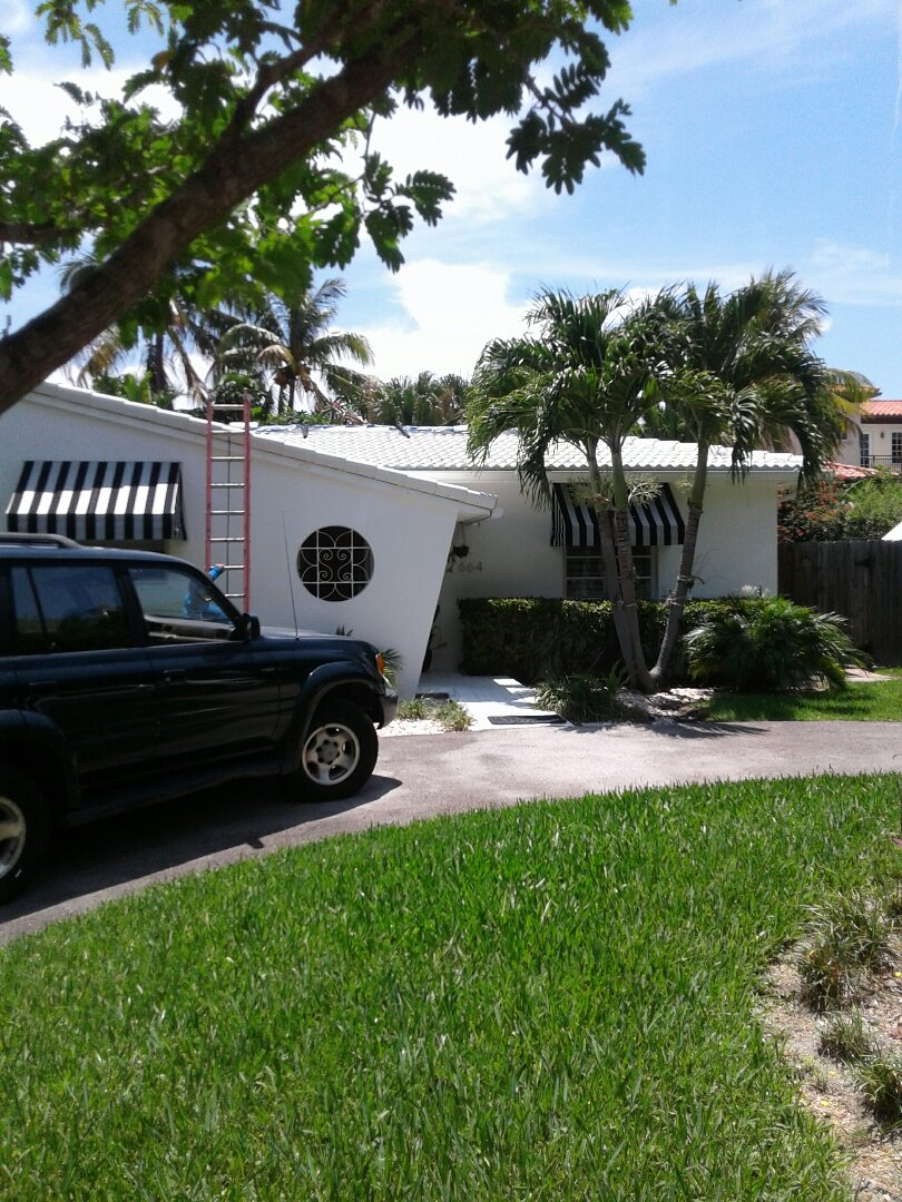 Key Biscayne, FL - Tile roof repair in the city of Key Biscayne Florida this repair is being done by Earl W Johnston roofing company Tony and Adam are you repair technicians