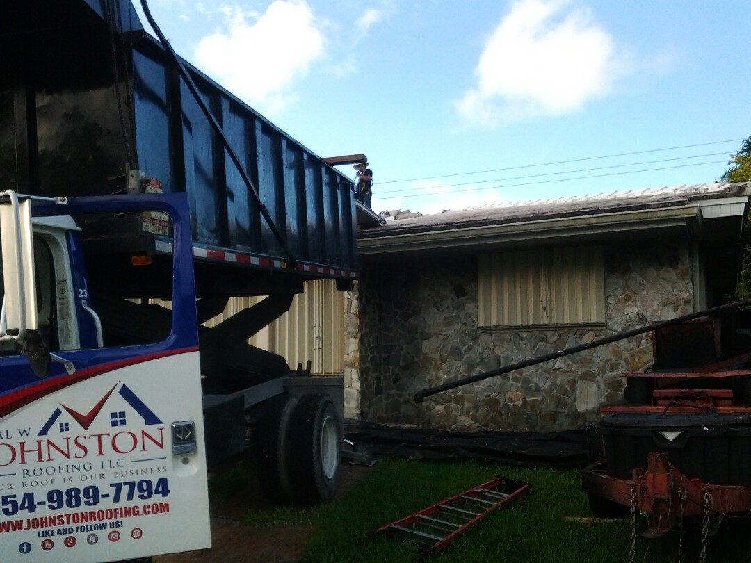 Miami, FL - Starting a tile reroof in North Miami, by Earl W. JOHNSTON ROOFING.