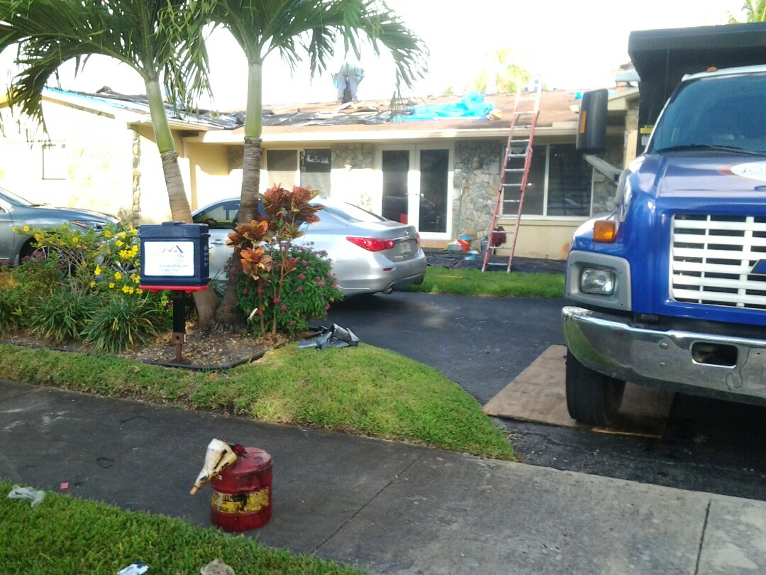 Miami, FL - Starting a 31sq shingle reroof in North Miami, by Earl W. JOHNSTON ROOFING.
