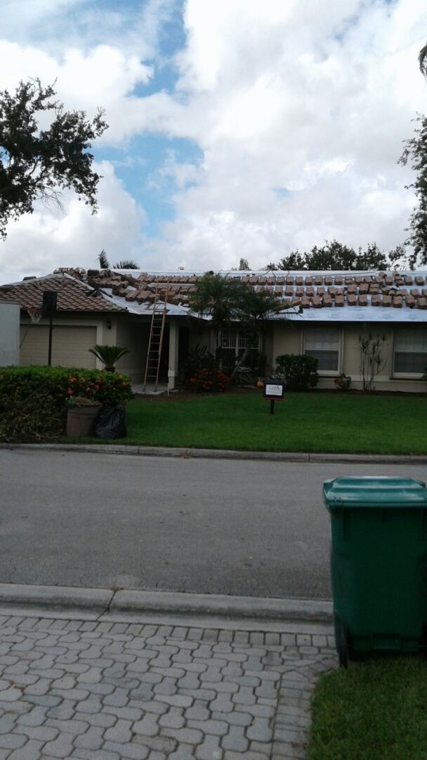 Coral Springs, FL - Entegra bella high s roof tile being installed by earl w Johnston roofing llc
