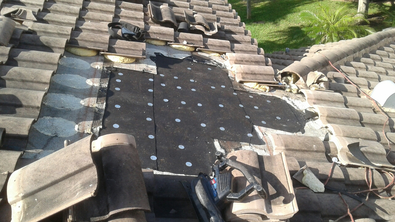 Coral Springs, FL - Mike and Earl Johnston roofing doing a tile repair