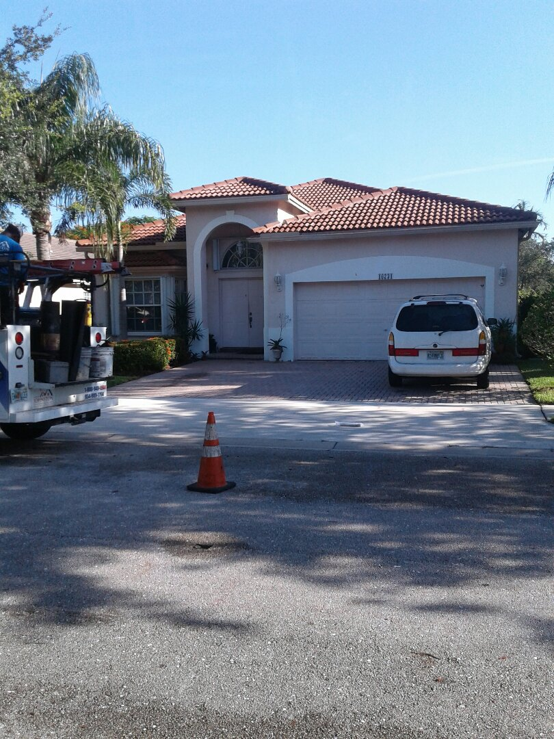 Weston, FL - Tile roof repair in the city of Weston Florida this repair is being done by Earl W Johnston roofing company Tony and Chris are your repair technicians