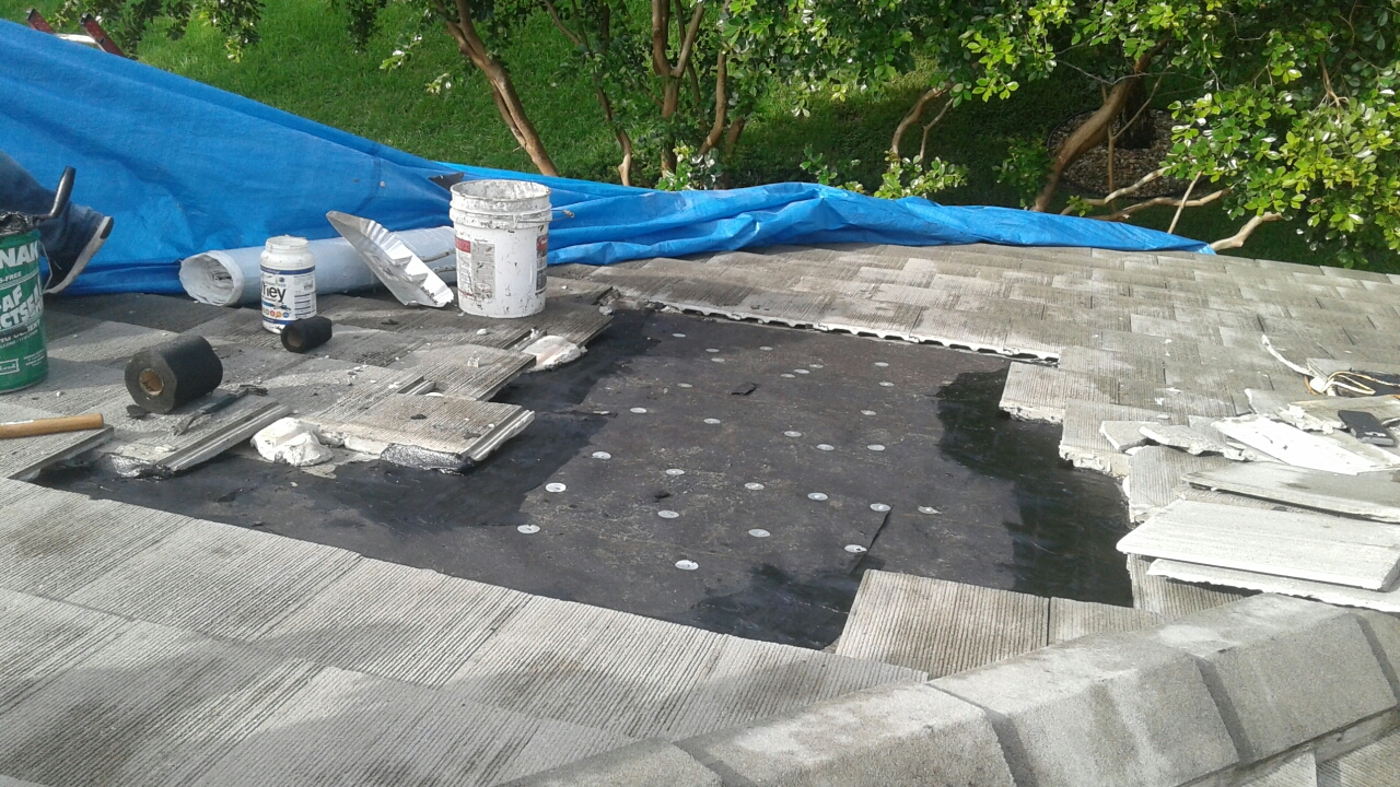 Weston, FL - Mike and Earl Johnston roofing ready to install second water barrier