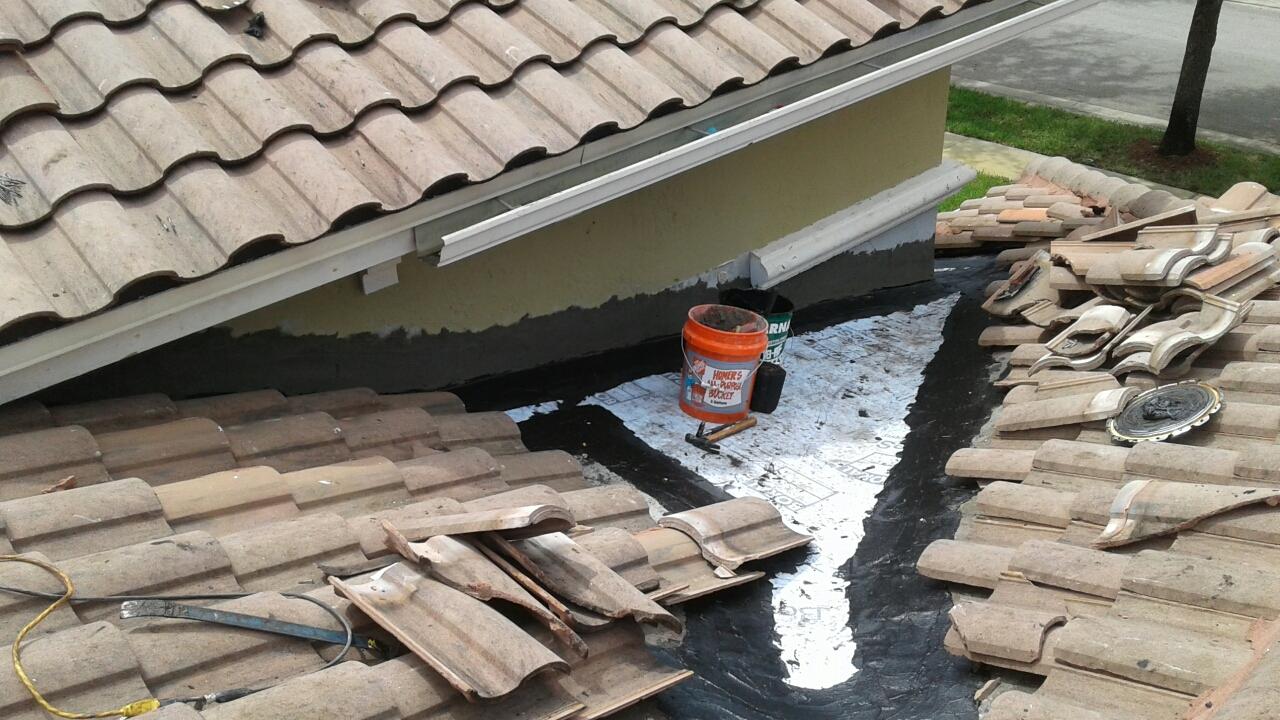 Mike and Earl Johnston roofing instilling tile
