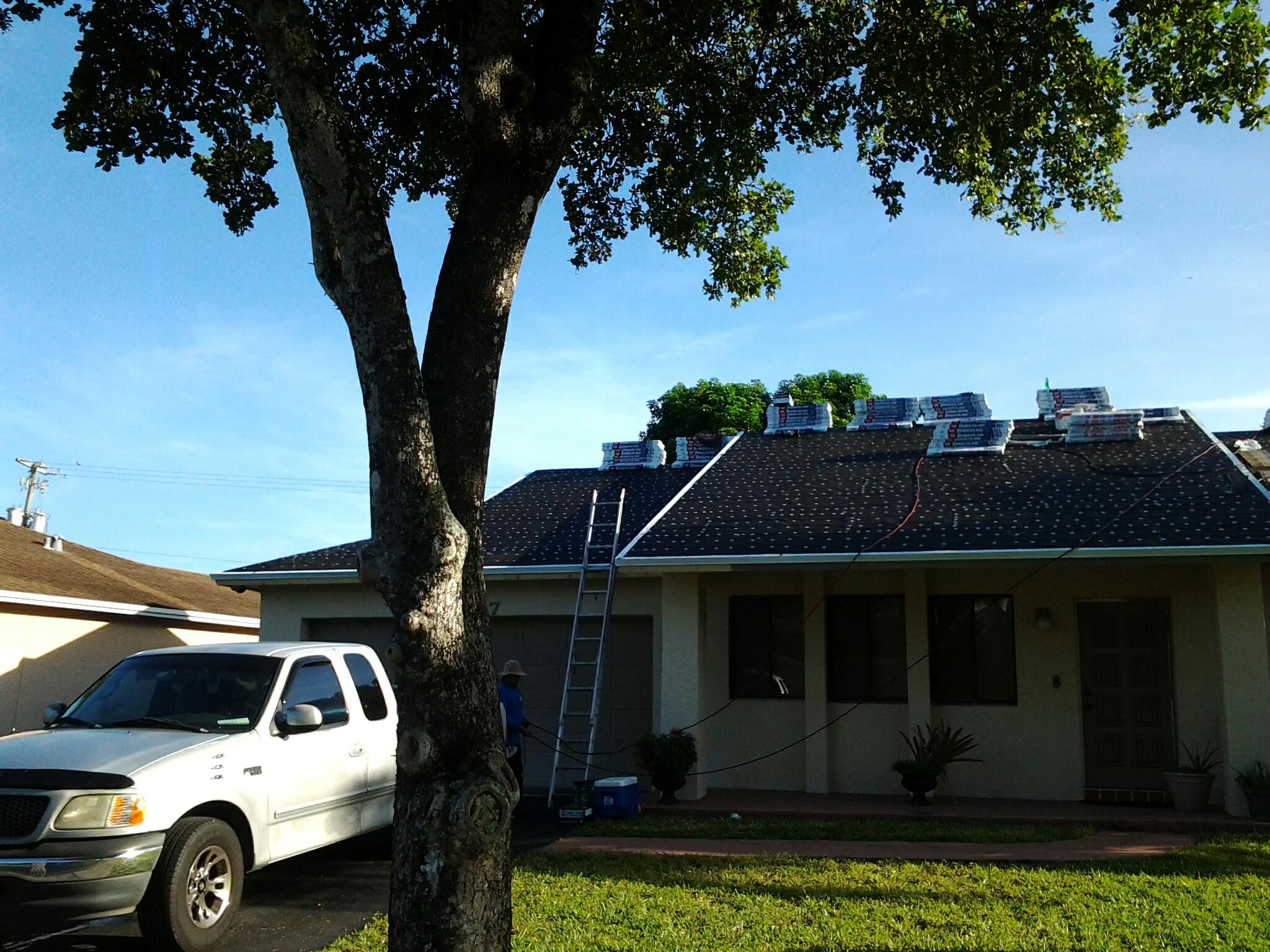 Applying stucco on new roof