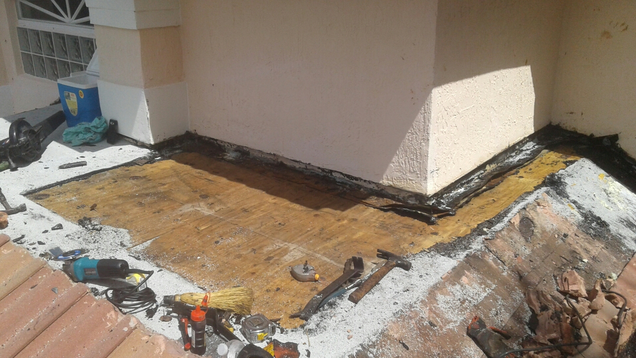Coral Springs, FL - Mike and Earl Johnston roofing doing a a flat roof repair
