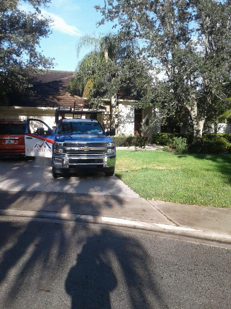 Weston, FL - 13 in broom swept roof tile repair in the city of Weston Florida this repair is being done by Earl W Johnston roofing company Tony and Chris are you repair technicians