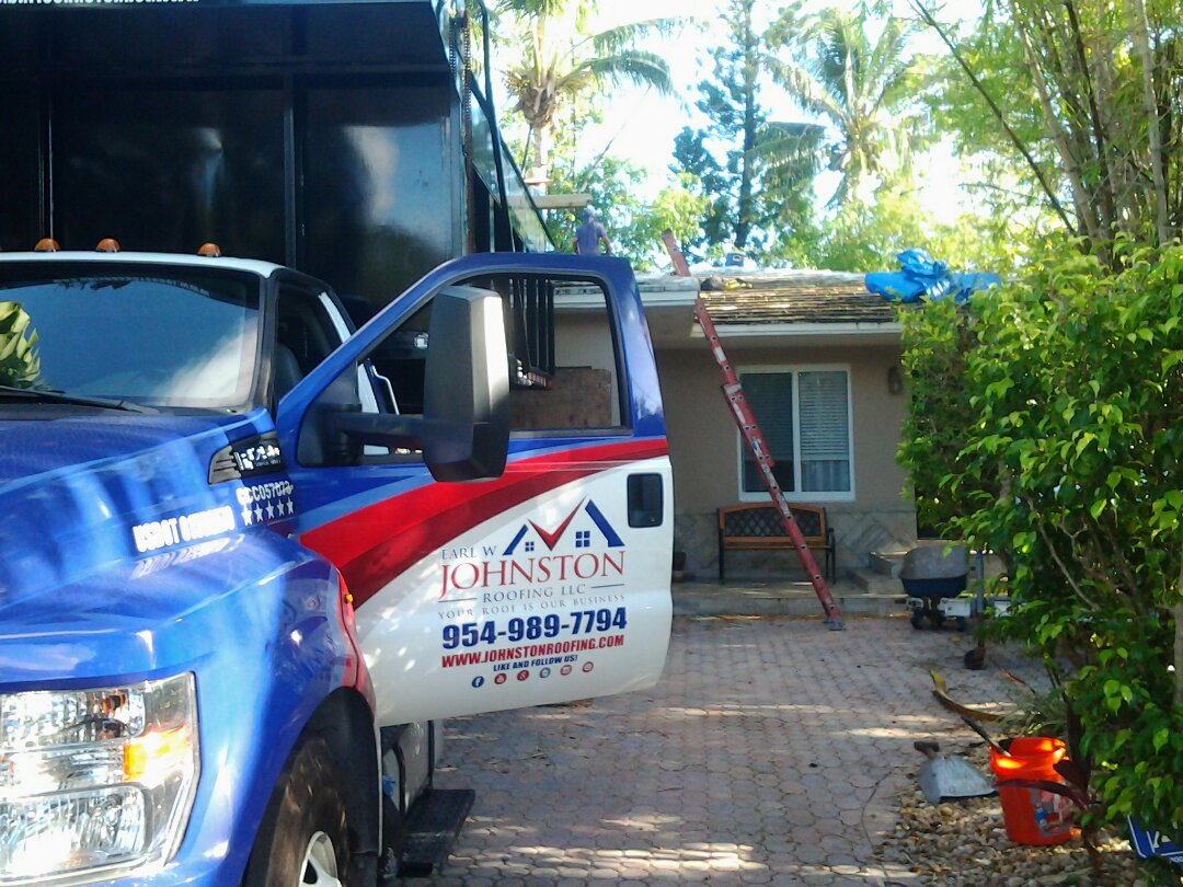 Miami, FL - Starting a 21sq tile reroof in Miami, by Earl W. JOHNSTON ROOFING.