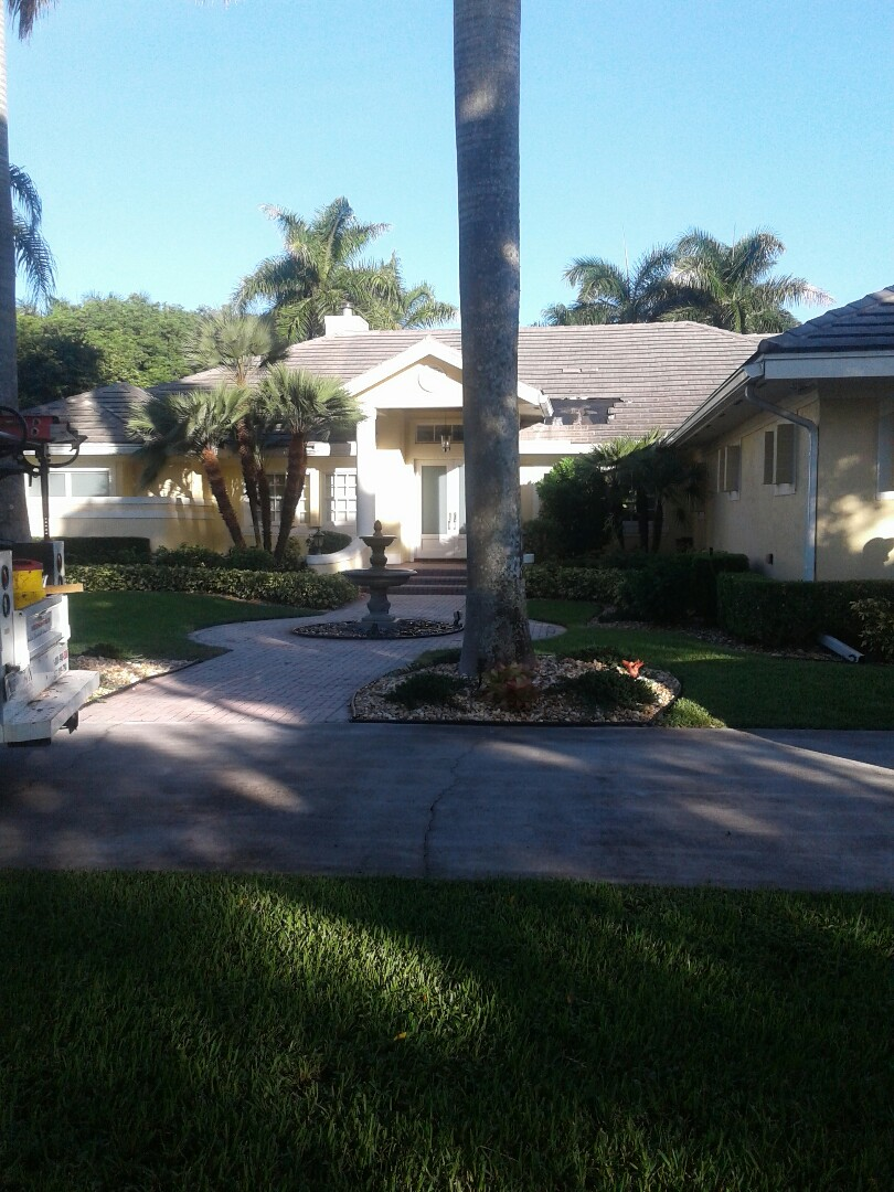 Weston, FL - Roof tile repair in the city of Weston Florida this repair is being done by Earl W Johnston roofing company Tony Chris and Brad are your repair technicians