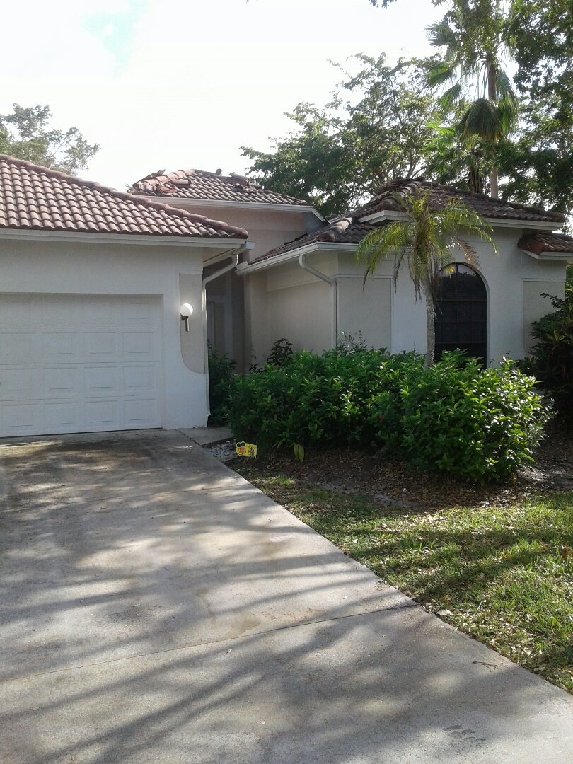 Hollywood, FL - Tile roof repair in the city of Cooper City Florida this repair is being done by Earl W Johnston roofing company Tony Chris and Gary are your repair technicians