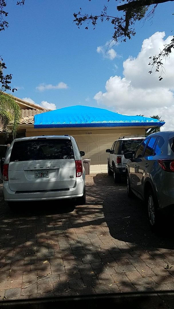 Coral Springs, FL - Tile roof repair estimate done by AJ from Earl Johnston Roofing
