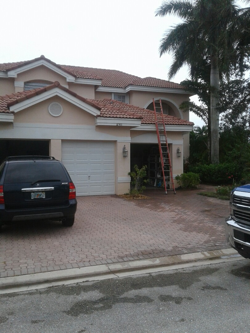 Coral Springs, FL - Roof tile repair in the City of Coral Springs Florida just repairs being done by Earl W Johnston roofing company Tony and Chris are your repair technician