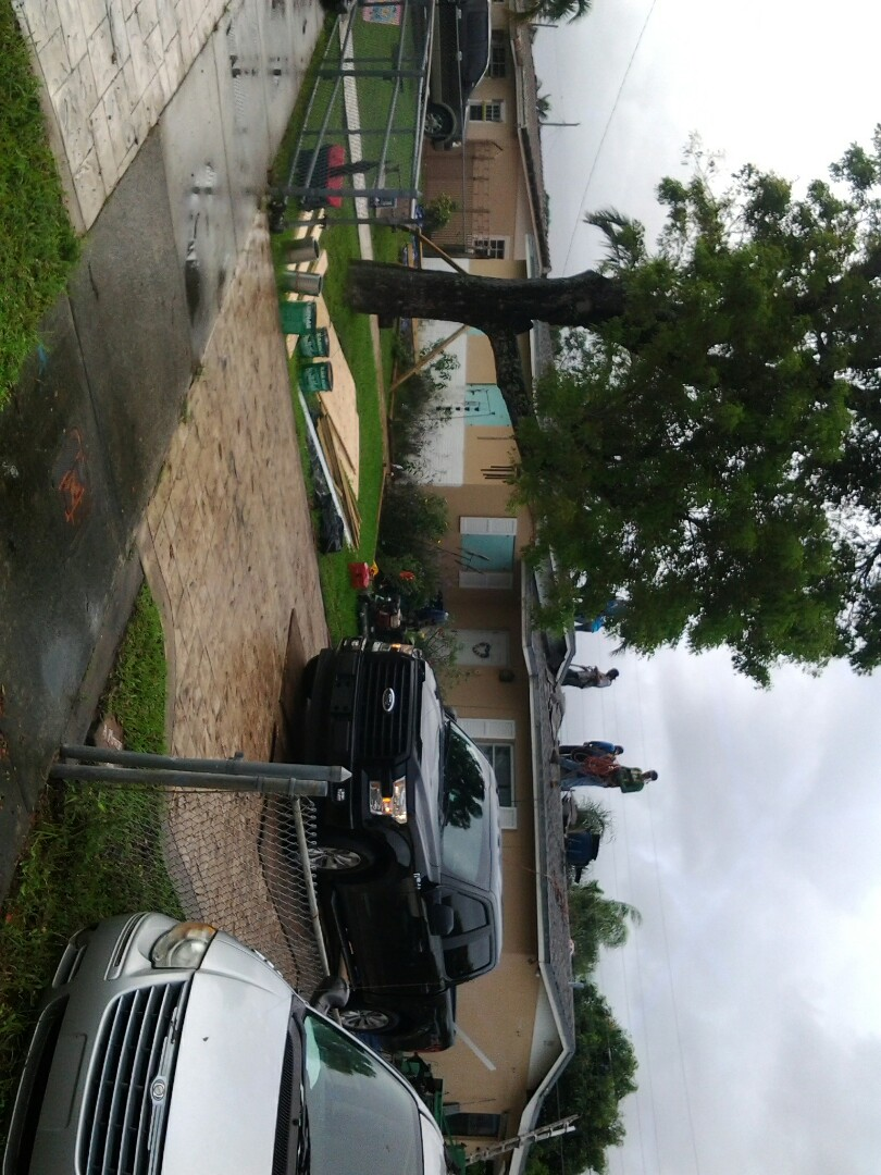 Hialeah, FL - Starting a shingle reroof in Miami, by Earl W. JOHNSTON ROOFING.