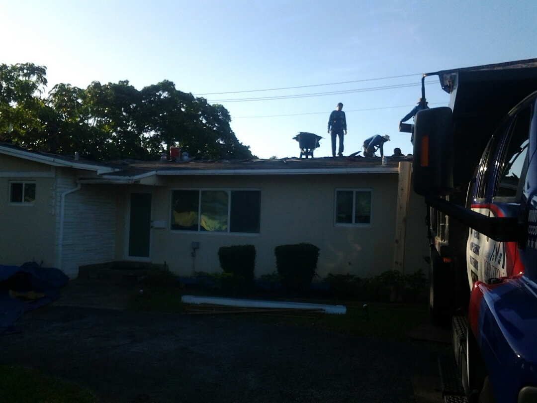 Hollywood, FL - Starting a 26sq shingle reroof in Hollywood, by Earl W. JOHNSTON ROOFING.