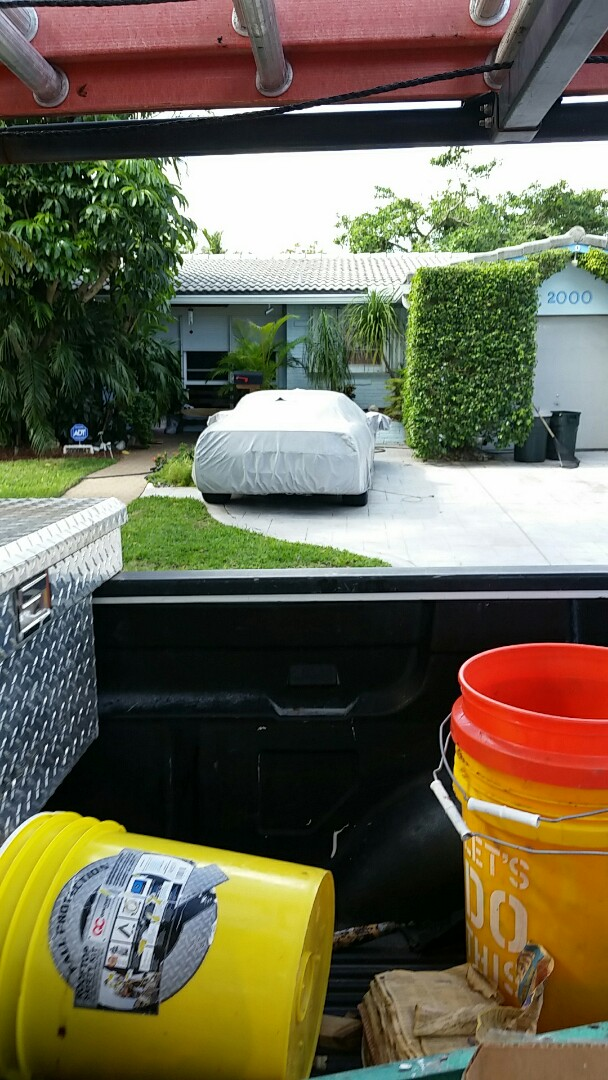 Hollywood, FL - Roof estimate for repairing a roof tile over a flat roof