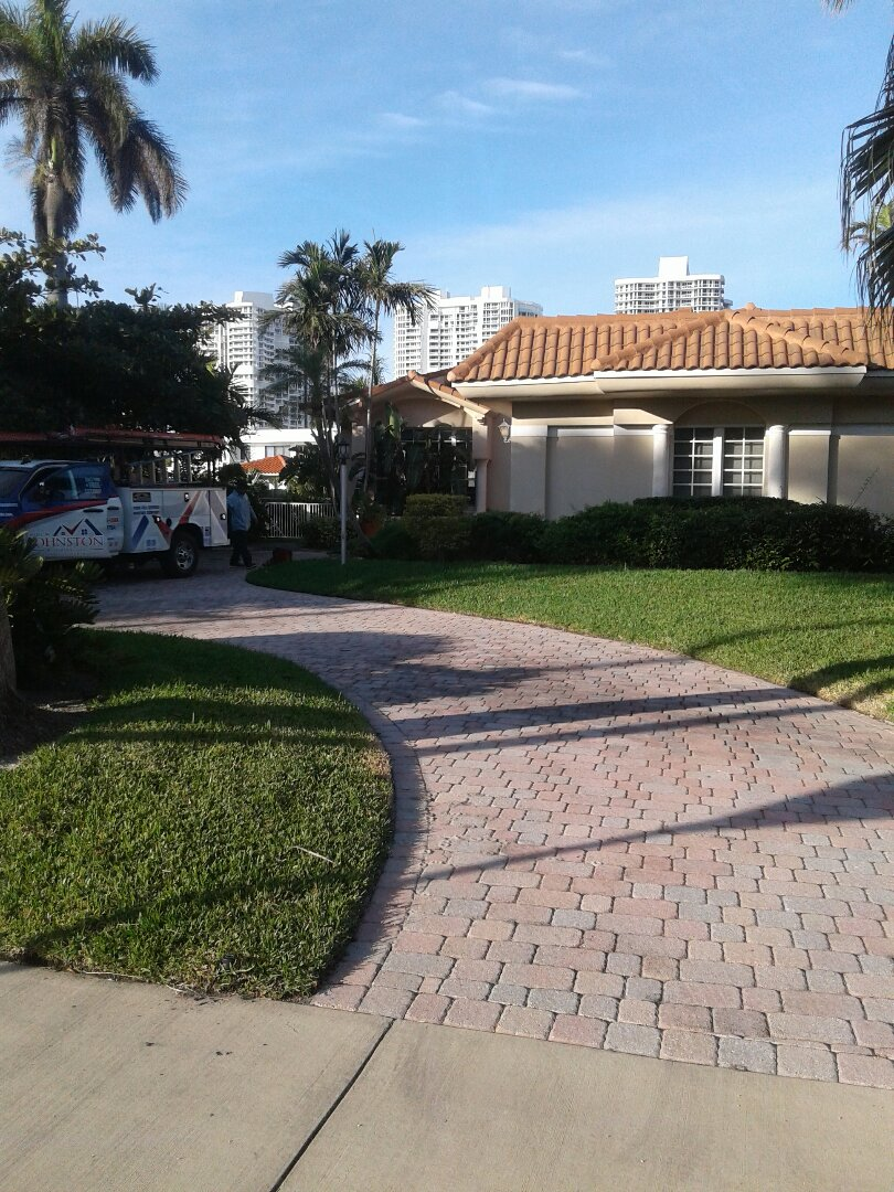 Golden Beach, FL - Roof tile repair in the city of golden Beach Florida this repairs being done by Earl W Johnston roofing company Tony and Jose are your repair technicians