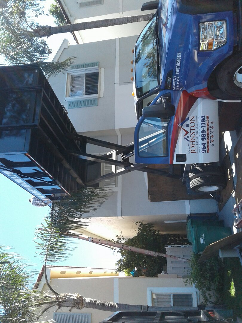 Hollywood, FL - Starting a 14sq tile reroof in cooper city, by Earl w Johnston roofing.