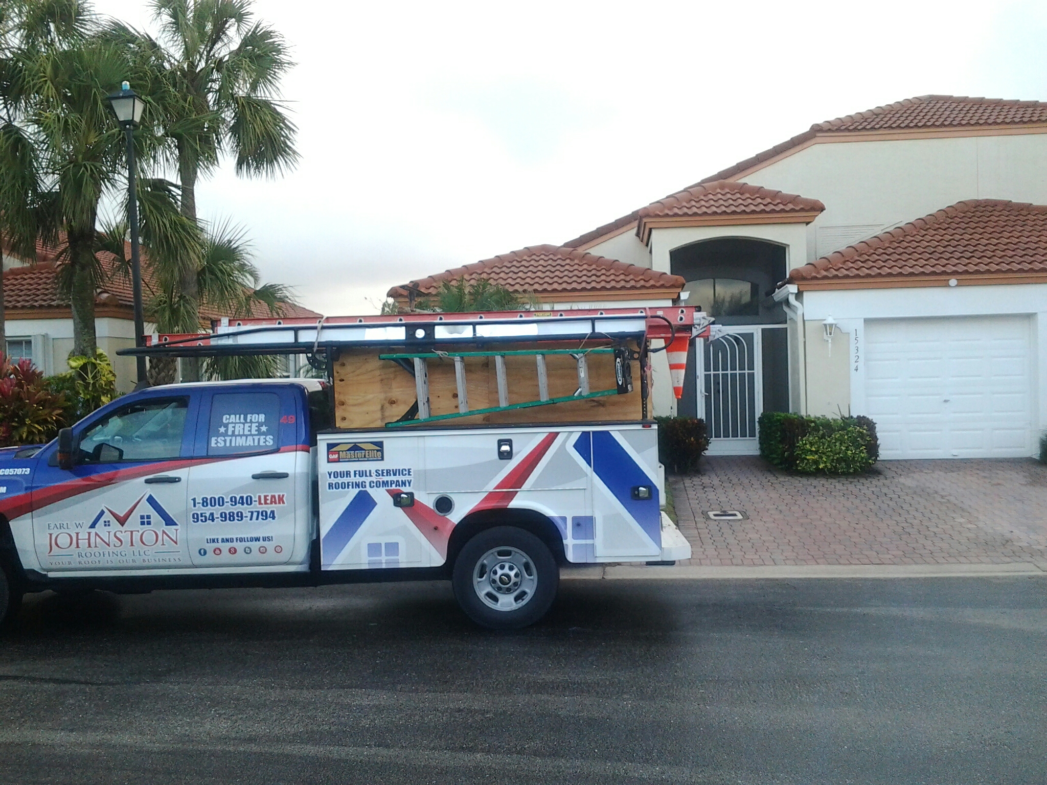 Delray Beach, FL - Tile roof repair in the city of Delray Beach fl this repair is being done by Earl w Johnston roofing company Jos? Deaune end Nathaniel