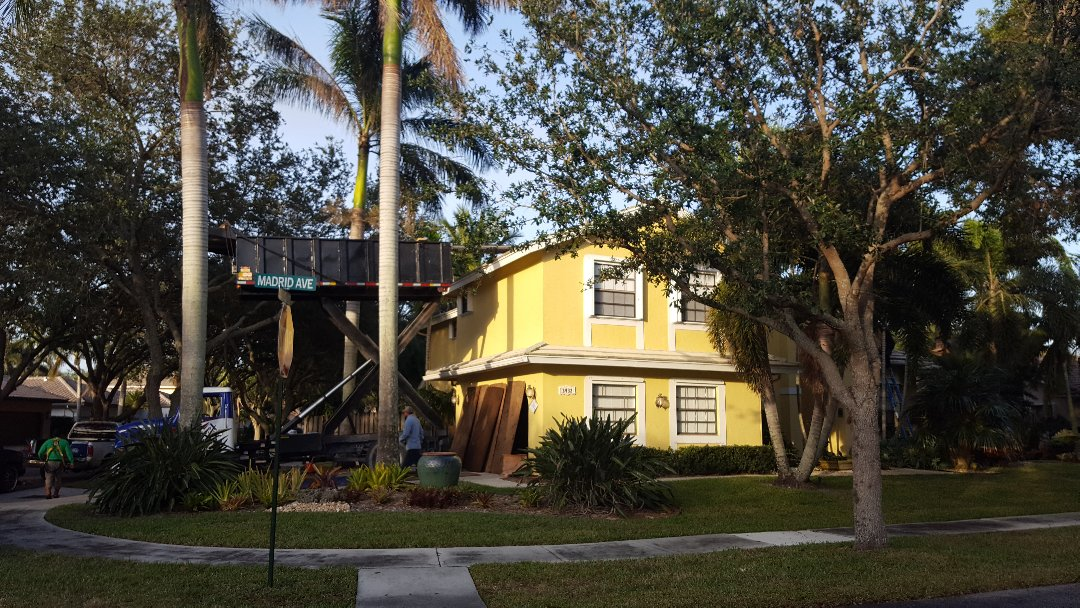 Hollywood, FL - Starting a tile tear off in embassy lakes