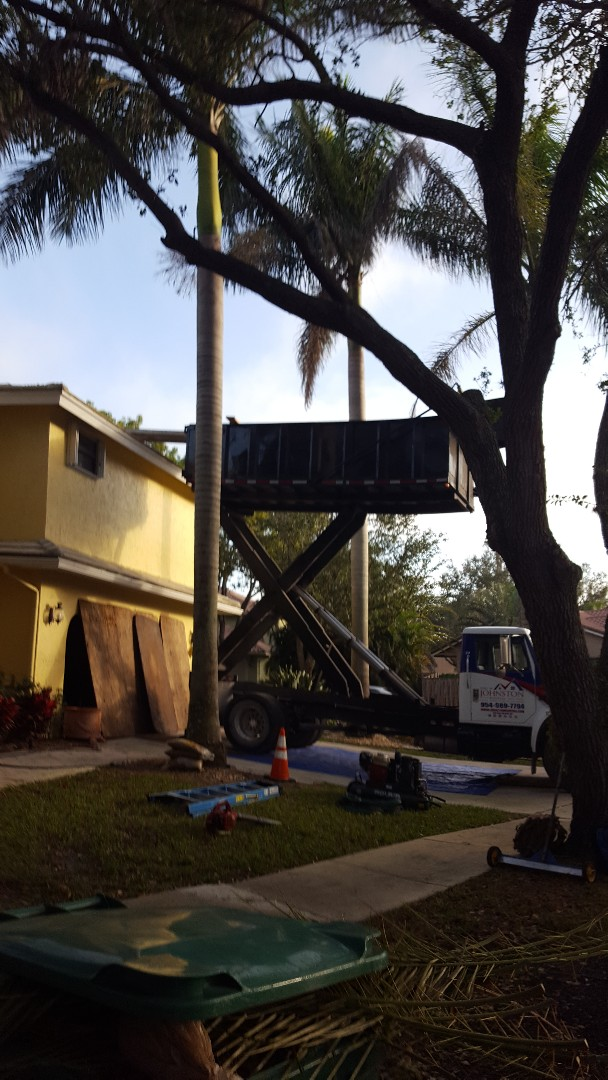 Hollywood, FL - Using the high lift and the ramp to control the debris