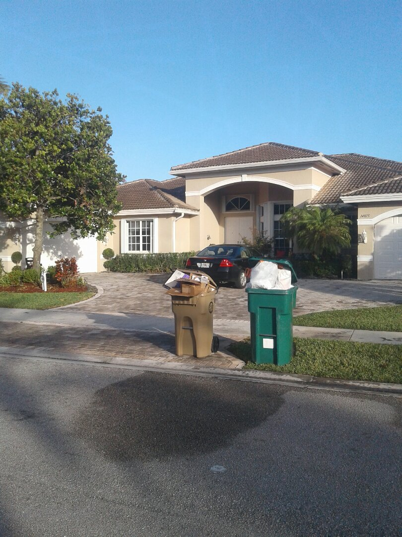 Roof tile repair in the city of Davie Florida this repair is being done by Earl W Johnston roofing company you repair technicians this morning or Tony Tavaris and Regis