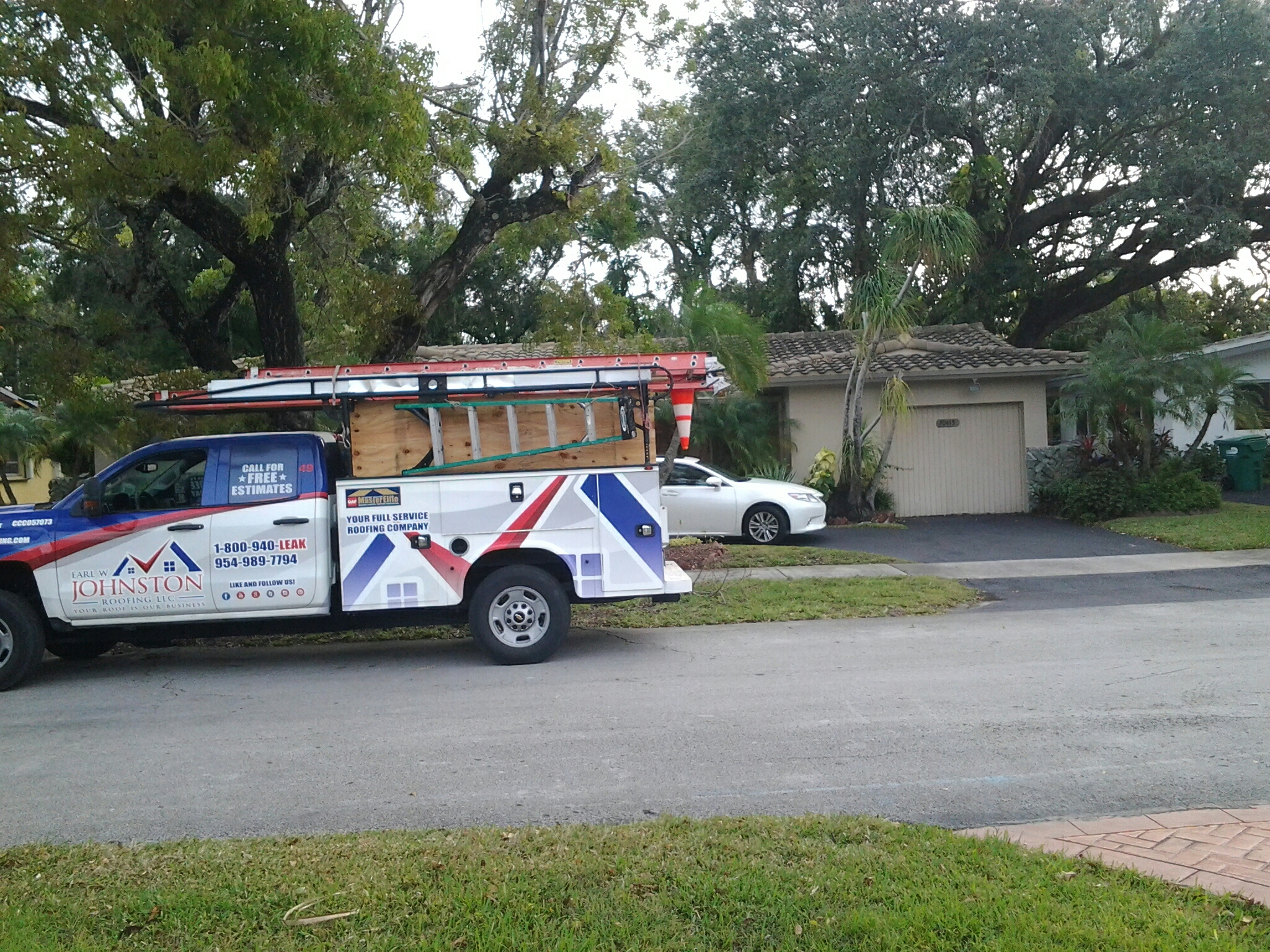 North Miami Beach, FL - Flat roof repair in the city of north miami beach fl this repair is being done by Earl w Johnston roofing company Jos? Deaune end Nathaniel are you repair technicians