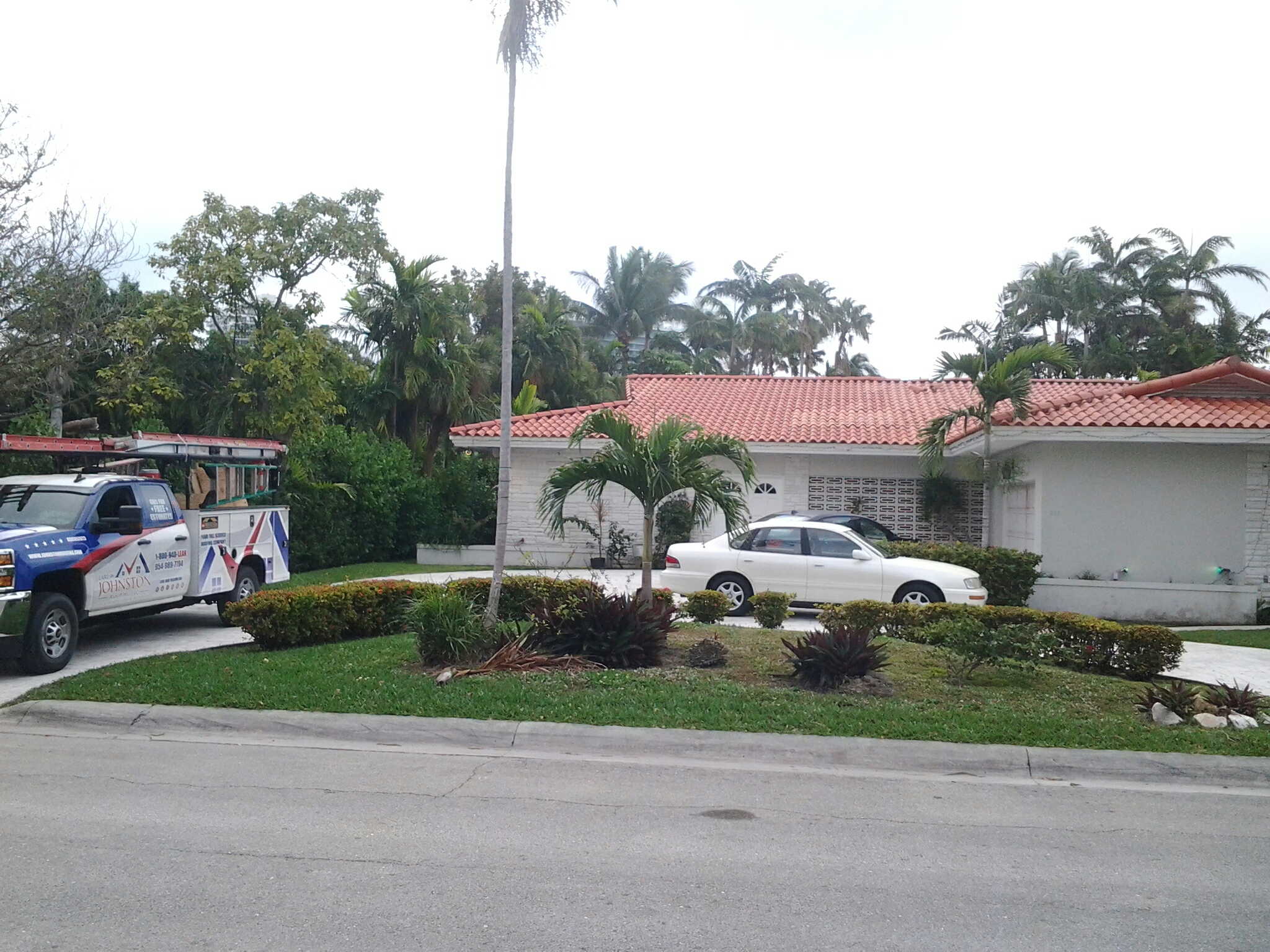 Bal Harbour, FL - Tile roof repair in the city of Bal Harbour fl this repair is being done by Earl w Johnston roofing company Jos? end Duane are you repair technicians