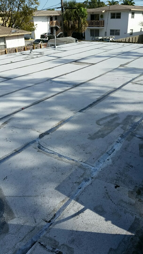 Oakland Park, FL - Roof check on a flat roof GAF mineral surface capsheet completed reroof in Oakland Park