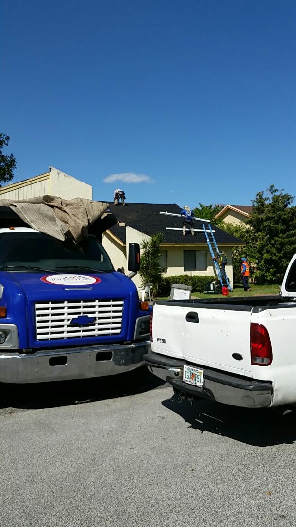 Lauderhill, FL - Inspecting a shingle reroof in progress in Lauderhill