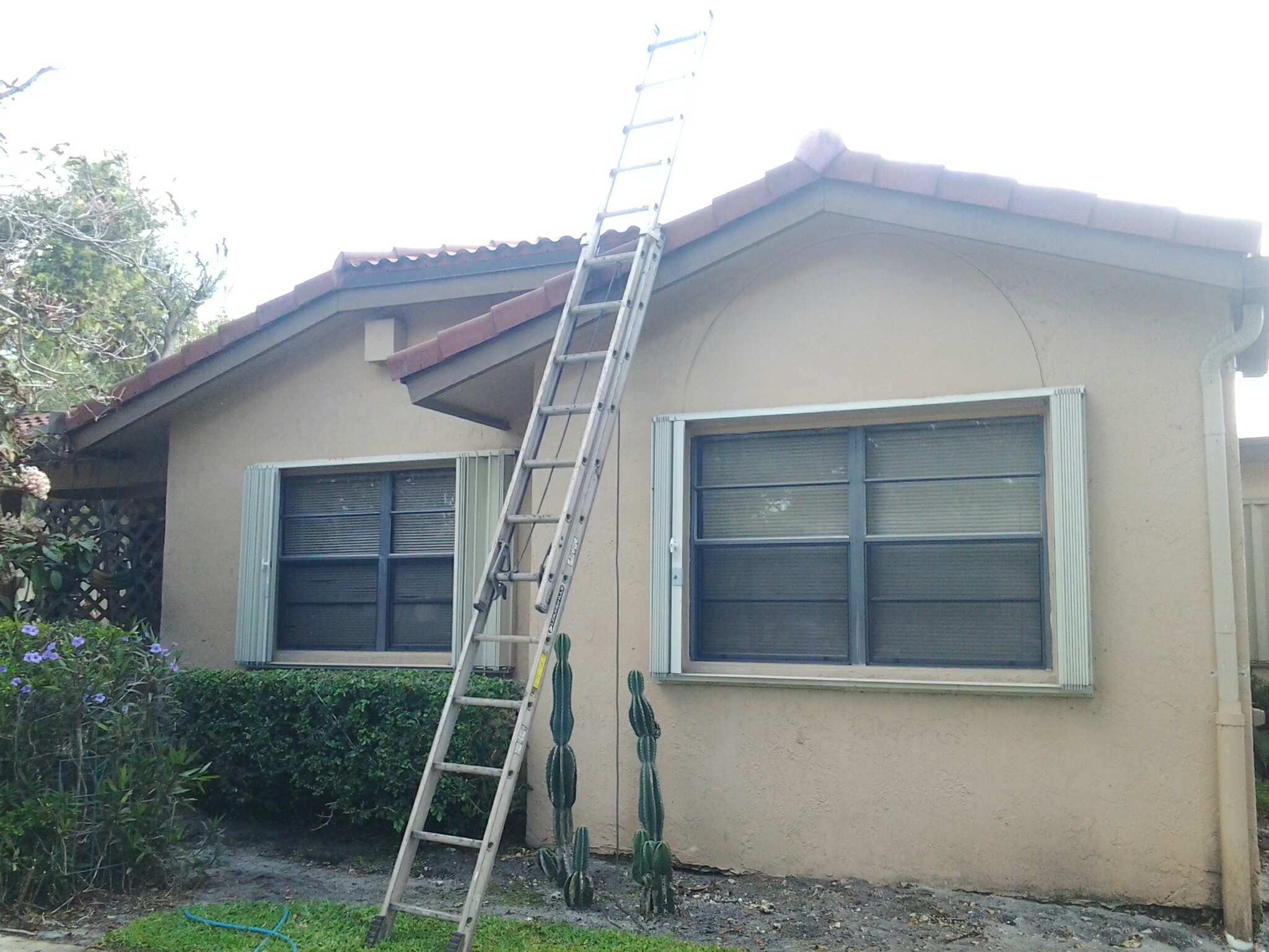 Hialeah, FL - Brandon and Gary applying roof aside