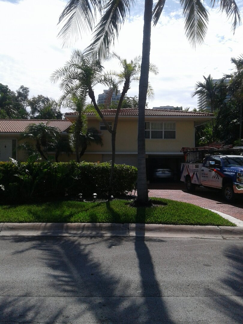Hollywood, FL - Tile roof repair in the City of BelHarbor Florida this repair is being done by Earl W Johnston roofing company Tony and Gary are you repair technicians