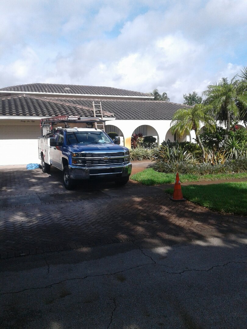 Hollywood, FL - Tile roof facial wood and soffit repair in the city of Hollywood Florida this repair is being done by Earl W Johnston roofing company Tony and Regis are your repair technicians