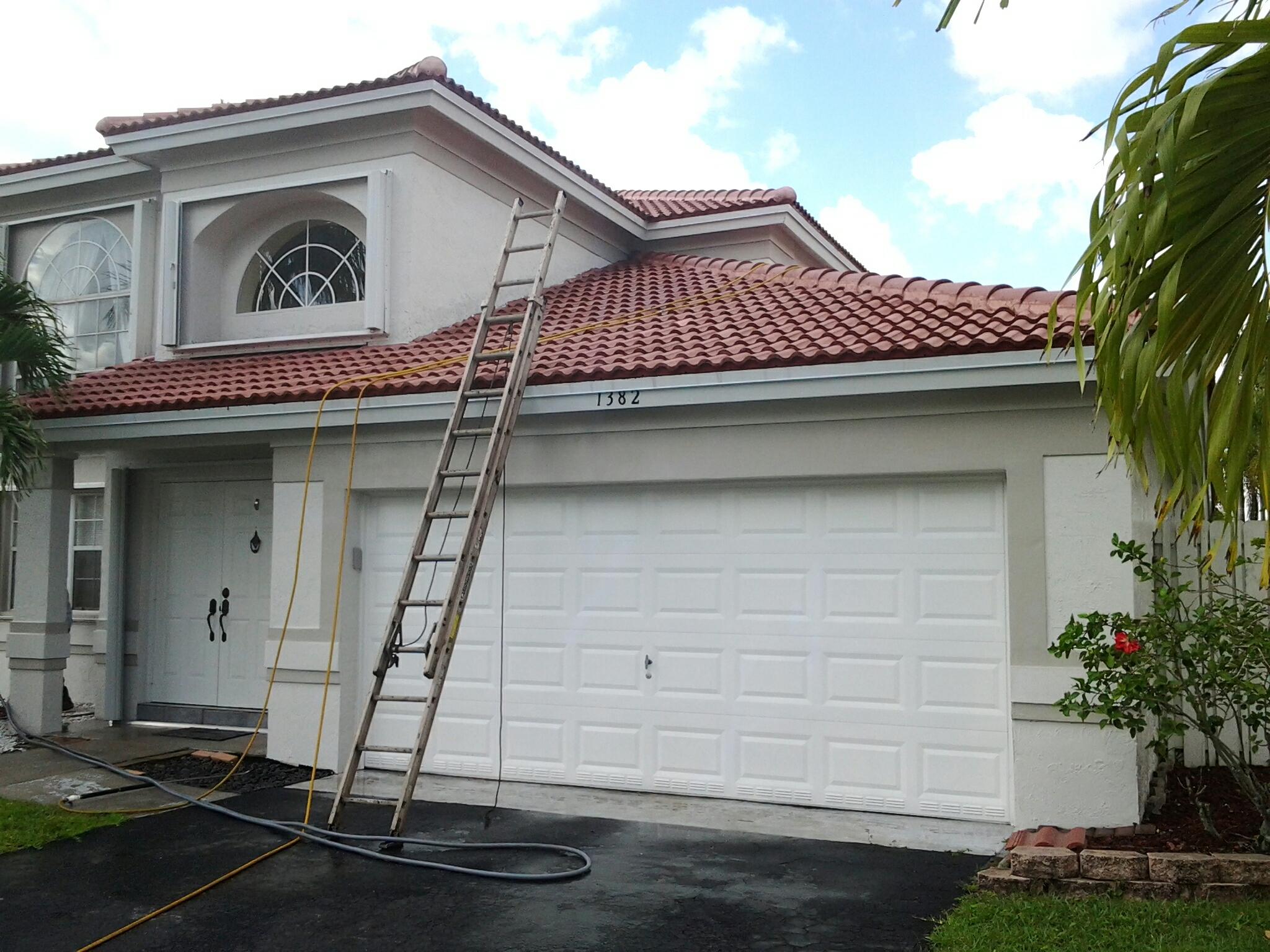Sunrise, FL - Brandon and Gary applying roof a cide