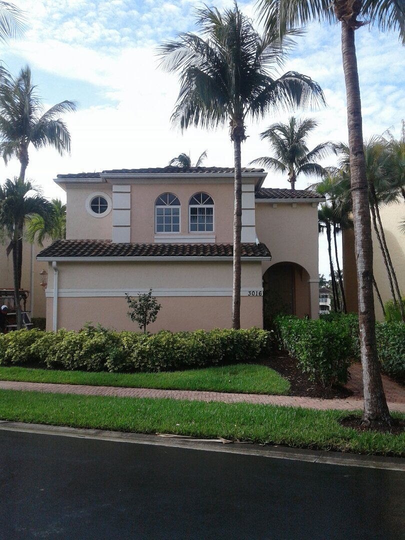 Aventura, FL - Tile roof repair in the City of Aventura Florida this repair is being done by Earl W Johnston roofing company Tony and Regis are your repair technicians