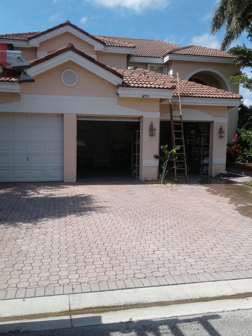 Coral Springs, FL - Roof tile repair in the City of Coral Springs Florida this repair is being done by Earl W Johnston roofing company Tony and Regis are your technicians
