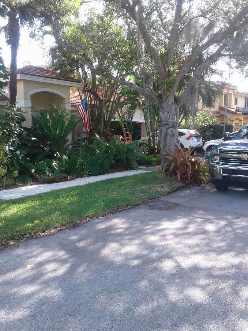 Hialeah, FL - Roof tile repair in the city of Miami Florida this repair is being done by Earl W Johnston roofing company Tony and Dwayne are your repair technicians