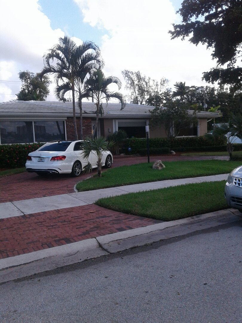 Hollywood, FL - Roof tile repair in the city of Hollywood Florida this repair is being done by Earl W Johnston roofing company Tony and Barry are you repair technicians